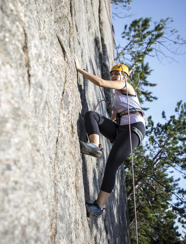 If you are new at something, help is always welcome. (image shows a rock climber on a sheer cliff face with a safety rope)