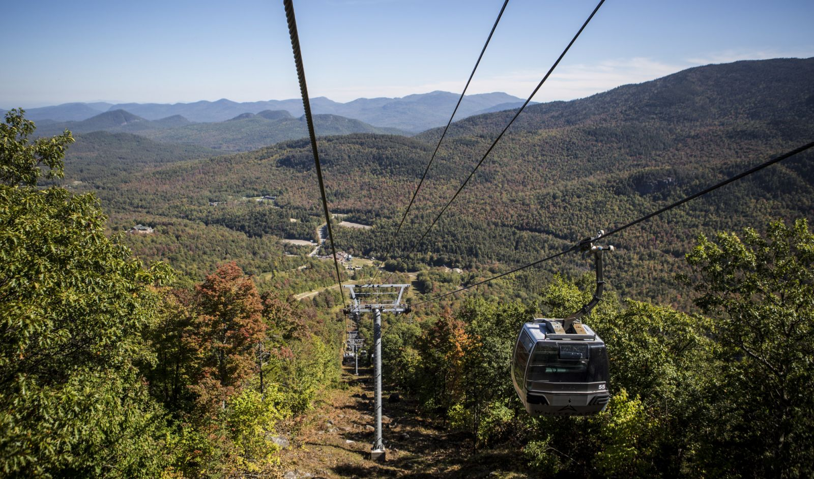 Sit back and enjoy the gondola ride to the summit of Little Whiteface.