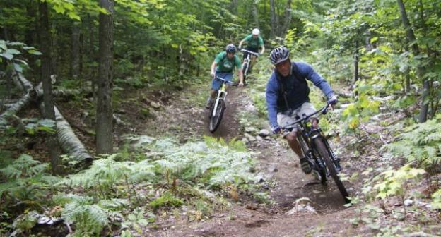 """Riders, beginning their descent from the top of """"Poor Man's Downhill"""""""