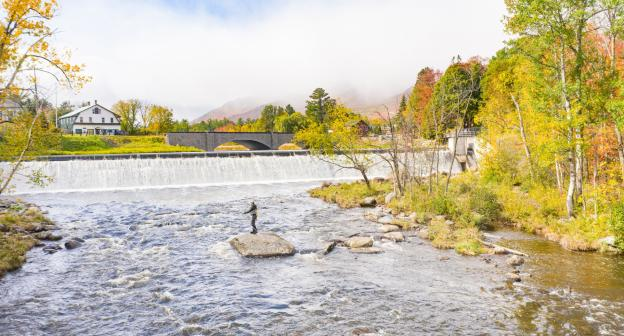 A fly fisherman casting on the Ausable River.