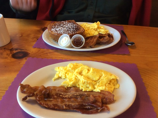In front, my breakfast. Behind it, my husband's order of the day's special, which has French toast and sausage along with the bacon and eggs.