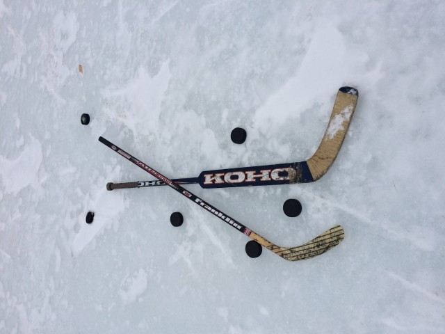 Our trusty thrift shop hockey equipment.