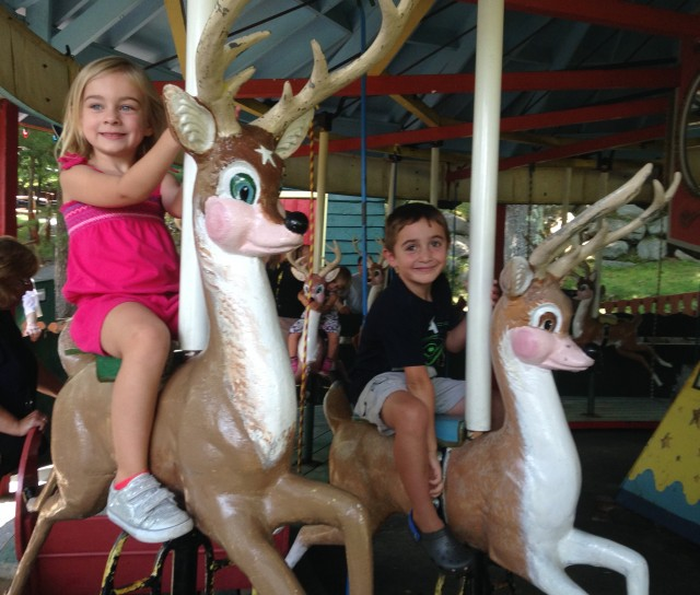 Cousins Julia & Oliver ride matching reindeer - of course.