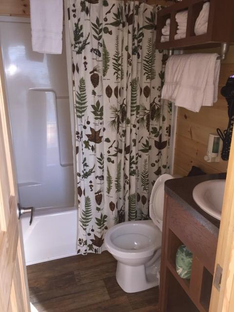 The cabin comes complete with a private bath. You win!