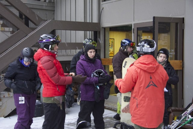 Sandy gives instructions before heading to the lift