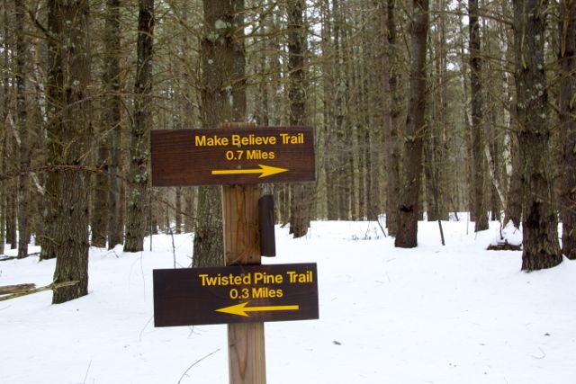 """Trail sign showing the way to the """"Make Believe"""" trail"""