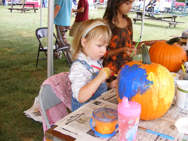 pumpkin painting, fun for kids at festival of colors