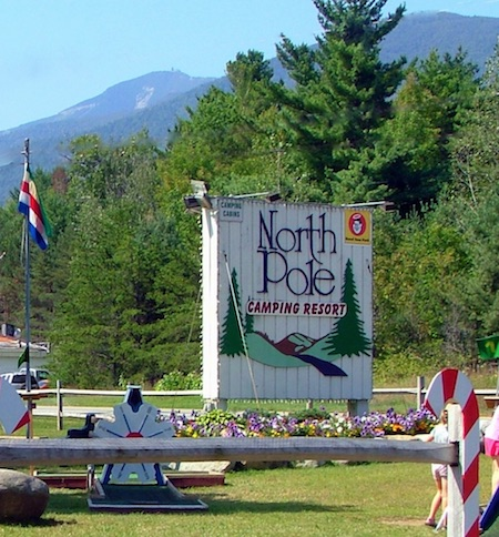 Enjoy North Pole Resort's 100 Acre Wood (image shows the sign and surrounding forest)